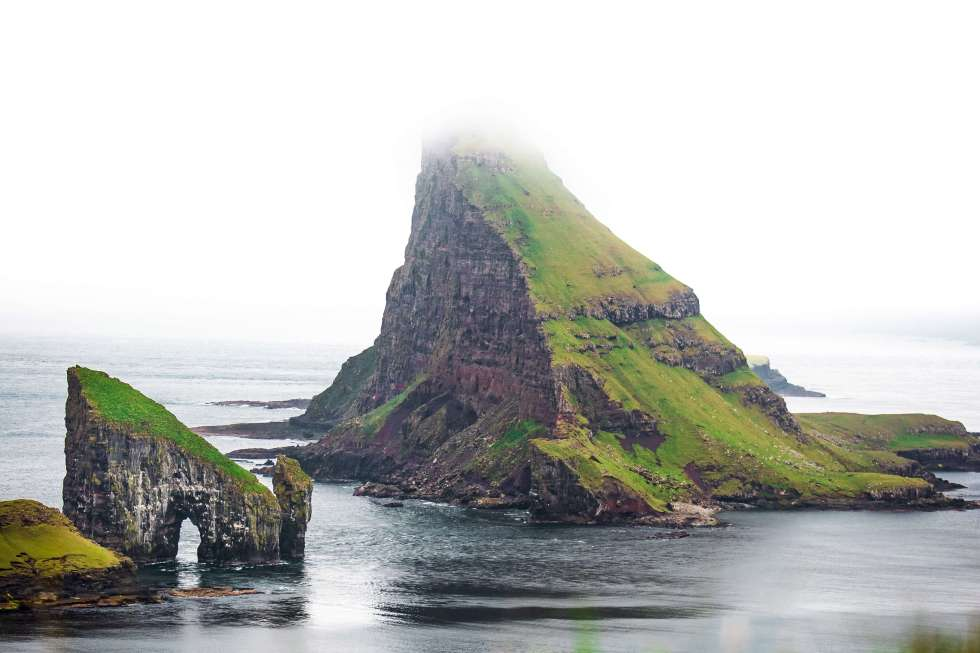 This image has an empty alt attribute; its file name is drangarnir-faroe-islands-fog-2582027-1.jpg